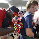 Boston Red Sox designated hitter David Ortiz, left, signs an autograph on a shirt for Kobe Kellar, 12, of Orange Park, Fla., second from right, before an exhibition baseball game against the Tampa Bay Rays, Tuesday, March 4, 2014, in Fort Myers, Fla. The