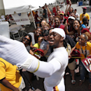 Washington Redskins quarterback Robert Griffin III takes a selfie with a group of fans after practice at the team's NFL football training facility, Monday, July 28, 2014 in Richmond, Va The Associated Press