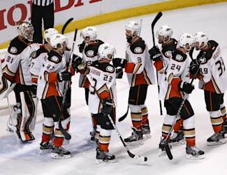 Anaheim Ducks players celebrate after defeating the Chicago Blackahwks 2-1 in Game 3 of the Western Conference finals in the NHL hockey Stanley Cup playoffs, Thursday, May 21, 2015, in Chicago. (AP Photo/Charles Rex Arbogast)