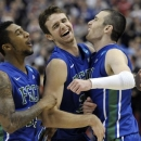 Florida Gulf Coast's Dajuan Graf, from left, Eddie Murray and Brett Comer celebrate after winning a third-round game against San Diego State in the NCAA college basketball tournament, Sunday, March 24, 2013, in Philadelphia. Florida Gulf Coast won 81-71. (AP Photo/Michael Perez)