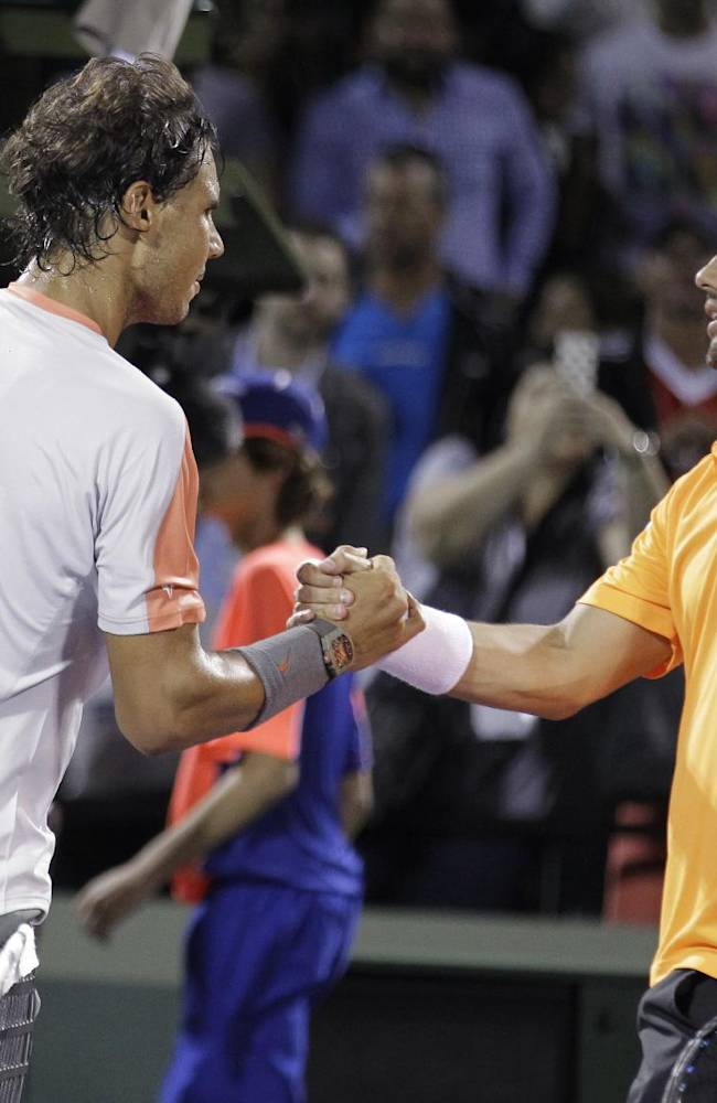 Rafael Nadal, left, of Spain, shakes hands with Fabio Fognini, of Italy, after Nadal's 6-2, 6-2 victory during the Sony Open tennis tournament Tuesday, March 25, 2014, in Key Biscayne, Fla