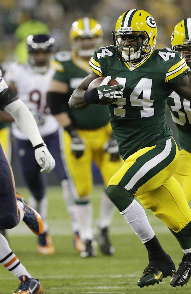 Green Bay Packers' James Starks (44) breaks away for a 32-yard touchdown run during the first half of an NFL football game against the Chicago Bears Monday, Nov. 4, 2013, in Green Bay, Wis
