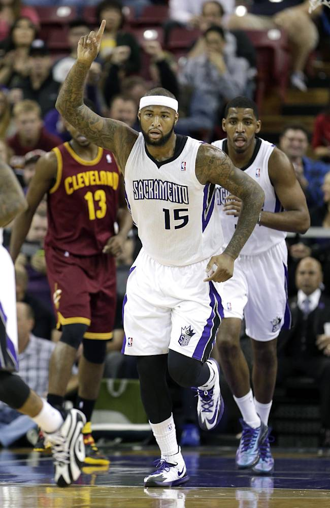 Sacramento Kings center DeMarcus Cousins gestures after scoring against the Cleveland Cavaliers during the first quarter of an NBA basketball game in Sacramento, Calif.,  Sunday, Jan. 12, 2014