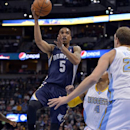 Memphis Grizzlies guard Courtney Lee (5) shoots over Denver Nuggets guard Randy Foye (4) and Timofey Mozgov (25) during the first quarter of an NBA basketball game on Monday, March 31, 2014, in Denver The Associated Press