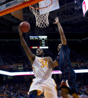 Tennessee's Jeronne Maymon (34) attempts to score while defended by Virginia's Justin Anderson during an NCAA college basketball game at Thompson-Boling Arena on Monday, Dec. 30, 2013, in Knoxville, Tenn. Tennessee won 87-52. (AP Photo/The Knoxville News Sentinel, Saul Young)