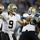 New Orleans Saints' Drew Brees (9) looks to pass under pressure from Carolina Panthers' Charles Johnson (95) in the second half of an NFL football game in Charlotte, N.C., Thursday, Oct. 30, 2014 The Associated Press