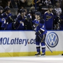 St. Louis Blues' Jaden Schwartz (9) celebrates with teammates on the bench after scoring a goal in the first period of an NHL