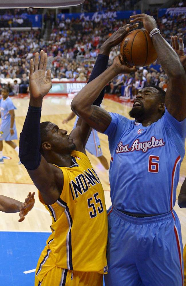 Los Angeles Clippers center DeAndre Jordan, right, has his shot blocked by Indiana Pacers center Roy Hibbert during the first half of an NBA basketball game, Sunday, Dec. 1, 2013, in Los Angeles