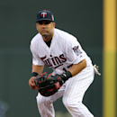 Minnesota Twins first baseman Kendrys Morales defends in the fourth inning of a baseball game against the Cleveland Indians, Monday, July 21, 2014, in Minneapolis. (AP Photo/Jim Mone)