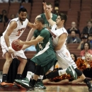 Cal Poly forward Travis Fulton (24) drives as Pacific forward Tony Gill, left, guard Rodrigo De Souza (21) and in the first half of an NCAA Big West tournament basketball game in Anaheim, Calif., Friday, March 15, 2013. (AP Photo/Reed Saxon)