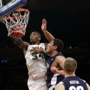 Baylor's Cory Jefferson (34) dunks as Brigham Young's Bronson Kaufusi defends during the first half of an NIT semifinal basketball game Tuesday, April 2, 2013, in New York. (AP Photo/Frank Franklin II)