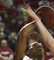 North Carolina State's T.J. Warren (24) shoots as Detroit's Evan Bruinsma (33) defends during the first half of an NCAA college basketball game at Reynolds Coliseum in Raleigh, N.C., Saturday, Dec. 14, 2013. (AP Photo/The News & Observer, Ethan Hyman)