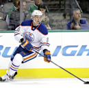 Edmonton Oilers defenseman Martin Marincin (85) of Slovakia prepares to pass the puck during an NHL hockey game against the Dallas Stars, Tuesday, Nov. 25, 2014, in Dallas. (AP Photo/Tony Gutierrez)