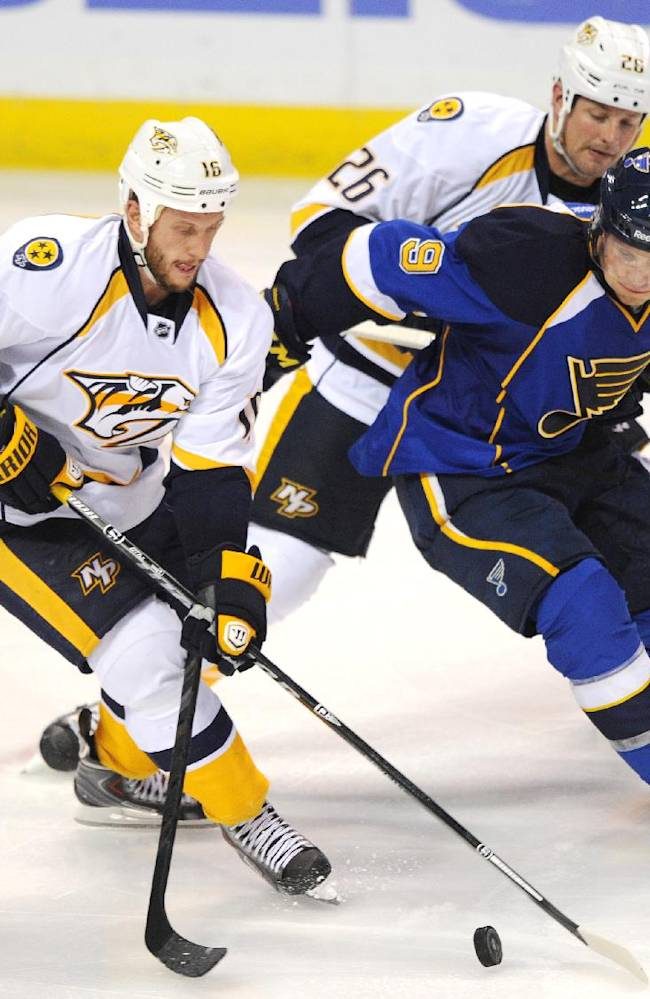 Nashville Predators' Rich Clune (16) and Matt Hendricks (26) battle with St. Louis Blues' Jaden Schwartz (9) for the puck during the second period of an NHL hockey game Thursday, Oct. 3, 2013, in St. Louis