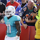 Miami Dolphins wide receiver Mike Wallace (11) celebrates a touchdown catch during the second half of an NFL football game against the Buffalo Bills, Sunday, Sept. 14, 2014, in Orchard Park, N.Y The Associated Press