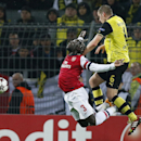 Arsenal s Bacary Sagna, left, is challenged by Dortmund s Sven Bender during the Champions League group F soccer match between Borussia Dortmund and Arsenal FC in Dortmund, Germany, Wednesday,Nov.6,2013