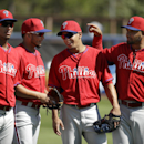 Philadelphia Phillies infielders, from the left, Ronny Cedeno, Freddy Galvis, Cesar Hernandez, and Andres Blanco stand together while warming up on the field before an exhibition baseball game against the Tampa Bay Rays, Monday, March 3, 2014, in Port Cha