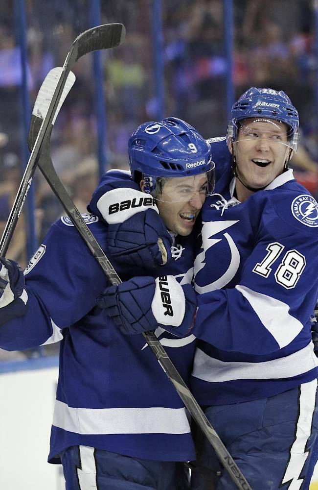 Tampa Bay Lightning center Tyler Johnson (9) celebrates with teammate left wing Ondrej Palat (18), of the Czech Republic, after Johnson scored against the Edmonton Oilers during the second period of an NHL hockey game on Thursday, Nov. 7, 2013, in Tampa, Fla