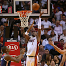 MIAMI, FL - OCTOBER 29: Chris Bosh #1 of the Miami Heat drives to the rim during the Opening night game against the Washington Wizards at American Airlines Arena on October 29, 2014 in Miami, Florida. (Photo by Mike Ehrmann/Getty Images)