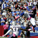 Buffalo Bills running back Anthony Dixon (26) hurdles New England Patriots cornerback Alfonzo Dennard (37) during the first half of an NFL football game Sunday, Oct. 12, 2014, in Orchard Park, N.Y The Associated Press