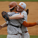 Texas pitcher Connor Mayes, right, hugs catcher Collin Shaw after Texas defeated Baylor in a semi-final game at the NCAA college Big 12 conference baseball tournament Saturday, May 23, 2015, in Tulsa, Okla. Texas won 4-0. (AP Photo/Sue Ogrocki)