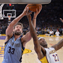 Memphis Grizzlies center Marc Gasol, left, of Spain, and Los Angeles Lakers forward Jordan Hill battle for a rebound during the first half of an NBA basketball game, Sunday, April 13, 2014, in Los Angeles The Associated Press
