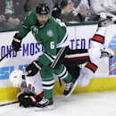 Dallas Stars defenseman Trevor Daley (6) knocks Ottawa Senators left wing Milan Michalek (9) into the boards during the second period an NHL Hockey game, Saturday, March 22, 2014, in Dallas. The Stars won 3-1 The Associated Press