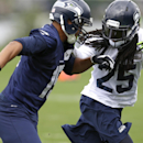 Seattle Seahawks cornerback Richard Sherman, right, covers wide receiver Jermaine Kearse, left, on the final day of NFL football training camp, Wednesday, Aug. 13, 2014, in Renton, Wash The Associated Press