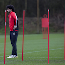 Manchester United's Marouane Fellaini trains with teammates at Carrington training ground in Manchester, Monday, Feb. 24, 2014. Manchester United will play Olympiakos in a Champions League first knockout round on Tuesday
