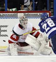 Tampa Bay Lightning right wing Martin St. Louis (26) scores past Detroit Red Wings goalie Jonas Gustavsson (50), of Sweden, during a shootout in an NHL hockey game Thursday, Dec. 12, 2013, in Tampa, Fla. The Lightning won the game 2-1. (AP Photo/Chris O'Meara)