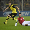 Dortmund s Marco Reus, left, and Arsenal s Mikel Arteta challenge for the ball during the Champions League group F soccer match between Borussia Dortmund and Arsenal FC in Dortmund, Germany, Wednesday, Nov. 6, 2013