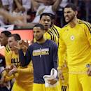 Indiana Pacers players cheer, from the bench, their team during the second half of Game 2 in their NBA basketball Eastern Conference finals playoff series Miami Heat, Friday, May 24, 2013, in Miami. (AP Photo/Lynne Sladky)