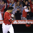 Los Angeles Angels' Hank Conger celebrates after he was hit by a pitch to force Raul Ibanez home to score the game winning run during the 11th inning of a baseball game against the New York Mets on Friday, April 11, 2014, in Anaheim, Calif. The Angels won