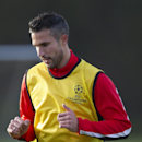 Manchester United's Robin van Persie trains with teammates at Carrington training ground in Manchester, Monday, Dec. 9, 2013. Manchester United will play Shakhtar Donetsk in a Champion's League Group A soccer match on Tuesday