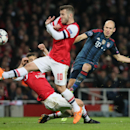 Bayern's Arjen Robben, rights, shoots against Arsenal's Jack Wilshere during a Champions League, round of 16, first leg soccer match between Arsenal and Bayern Munich at the Emirates stadium in London, Wednesday, Feb. 19, 2014