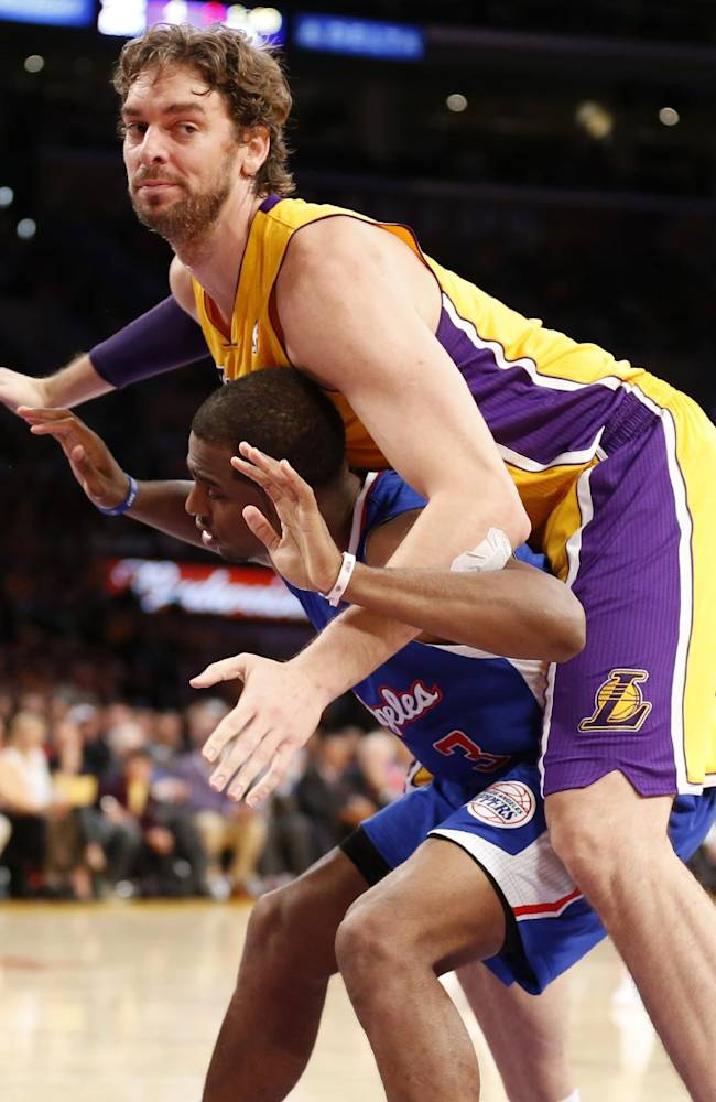 Los Angeles Clippers' Chris Paul, bottom, tries to box out Los Angeles Lakers' Pau Gasol, top, of Spain, during the first half of an NBA basketball game in Los Angeles, Tuesday, Oct. 29, 2013