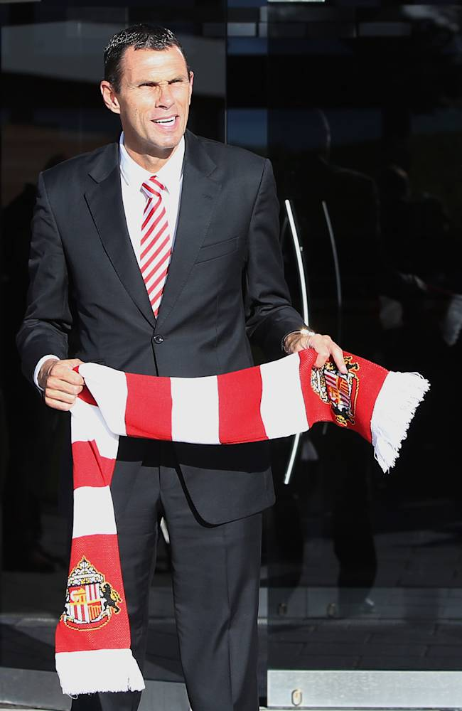 Newly appointed Sunderland soccer team manager Gus Poyet walks out of  the Academy of Light for a media photo call in, Sunderland, England, Tuesday, Oct. 8, 2013. Poyet has been hired as the new manager of Sunderland after the departure of manager Paolo Di Canio which has left the club bottom place in the English Premier League relegation zone