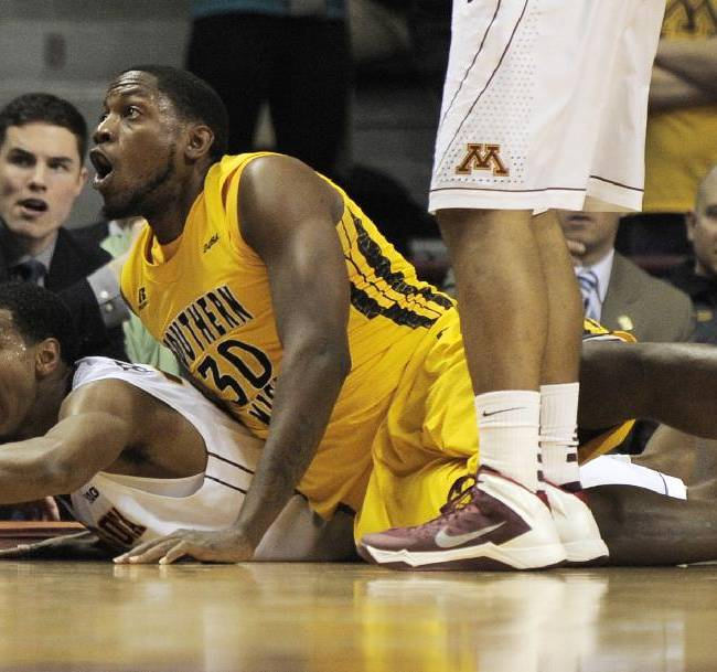 Minnesota's Austin Hollins, left, beats Southern Mississippi's Jeremiah Eason, right, to a loose ball during the second half of an NCAA college basketball game in the third round of the National Invitational Tournament in Minneapolis, Tuesday, March 25, 2014