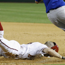 Arizona Diamondbacks' Tony Campana dives head first but is out at first base after New York Mets pitcher Carlos Torres, right, took the throw during the seventh inning of a baseball game on Monday, April 14, 2014, in Phoenix. The Mets defeated the Diamon