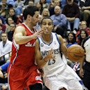 Minnesota Timberwolves' Kevin Martin, right, drives into Los Angeles Clippers' J.J. Redick in the first quarter of an NBA basketball game, Wednesday, Nov. 20, 2013, in Minneapolis The Associated Press