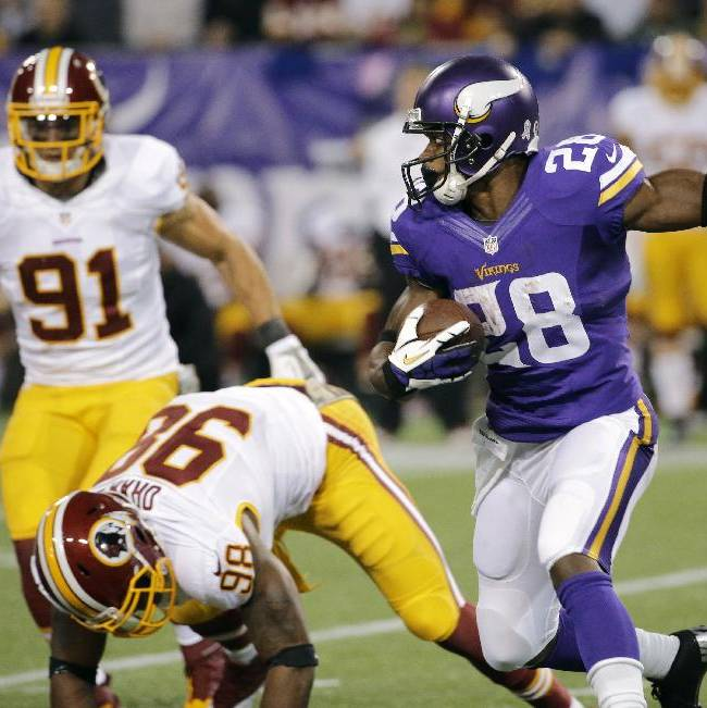 Minnesota Vikings running back Adrian Peterson, right, runs from Washington Redskins outside linebacker Brian Orakpo and outside linebacker Ryan Kerrigan (91) during the first half of an NFL football game Thursday, Nov. 7, 2013, in Minneapolis