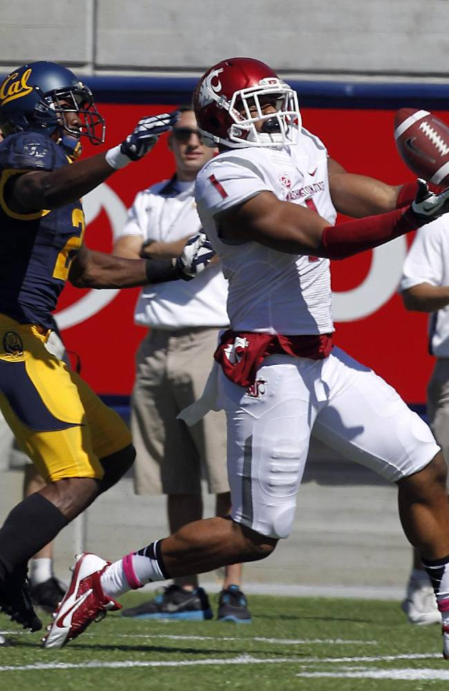 Washington State wide receiver Vince Mayle (1) catches a touchdown pass against California defensive back Isaac Lapite (20) during the first half of an NCAA college football game in Berkeley, Calif., Saturday, Oct. 5, 2013