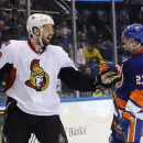 Ottawa Senators' Matt Kassian (28) celebrates his empty-net goal as New York Islanders' Anders Lee (27) skates past during the third period of an NHL hockey game Tuesday, April 8, 2014, in Uniondale, N.Y. The Senators won 4-1 The Associated Press