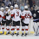 Ottawa Senators' Kyle Turris (7), Mike Hoffman (68), Bobby Ryan (6), Marc Methot (3) and Erik Karlsson (65) celebrate Turris' goal on Winnipeg Jets' goaltender Ondrej Pavelec (31) during the second period of an NHL hockey game, Saturday, March 8, 2014 in