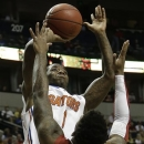 Florida guard Kenny Boynton (1) heads to the basket as Alabama guard Trevor Lacey (5)defends during the first half of an NCAA college basketball game at the Southeastern Conference tournament, Saturday, March 16, 2013, in Nashville, Tenn. (AP Photo/Dave Martin)