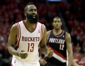 Houston Rockets' James Harden (13) reacts after being called for his sixth foul of the game against the Portland Trail Blazers during the fourth quarter in Game 2 of an opening-round NBA basketball playoff series Wednesday, April 23, 2014, in Houston. Portland won 112-105. (AP Photo/David J. Phillip)
