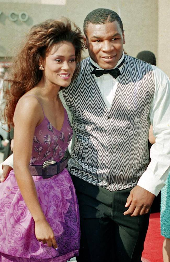 In this Aug. 20, 1988, file photo, actress Robin Givens and her husband, heavyweight boxing champion Mike Tyson, arrive at the 40th annual Emmy Awards in Pasadena, Calif. At one time he was the baddest man on the planet, a heavyweight champion who terrorized anyone who got in his way, inside the ring or out. It turns out that Tyson didn't tell us everything. Not to worry, because he's taken care of that in a hefty autobiography that might be the most soul baring book of its genre ever written