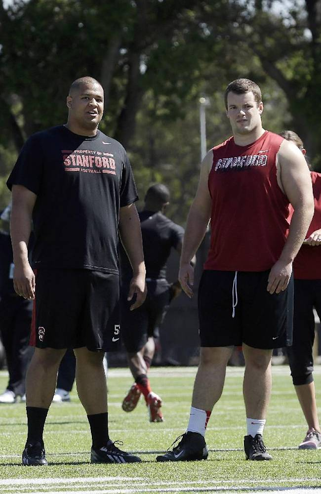 Stanford guard David Yankey, left, talks with guard Kevin Danser during pro day for NFL football representatives in Stanford, Calif., Thursday, March 20, 2014