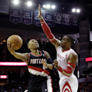 Portland Trail Blazers' Damian Lillard (0) goes up to shoot as Houston Rockets' Dwight Howard (12) defends during the first quarter of an NBA basketball game on Sunday, March 9, 2014, in Houston The Associated Press