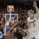 Virginia Tech guard Robert Brown tries to get past Virginia guard Paul Jesperson (2) during the first half of an NCAA college basketball game Tuesday, Feb. 12, 2013, in Charlottesville, Va. (AP Photo/Steve Helber)